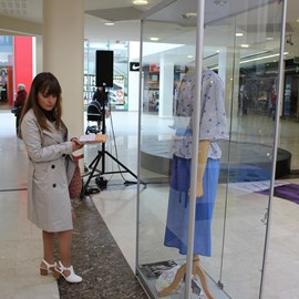 A shopper learning about garments from the past supplied by Grosvenor museum.JPG thumbnail